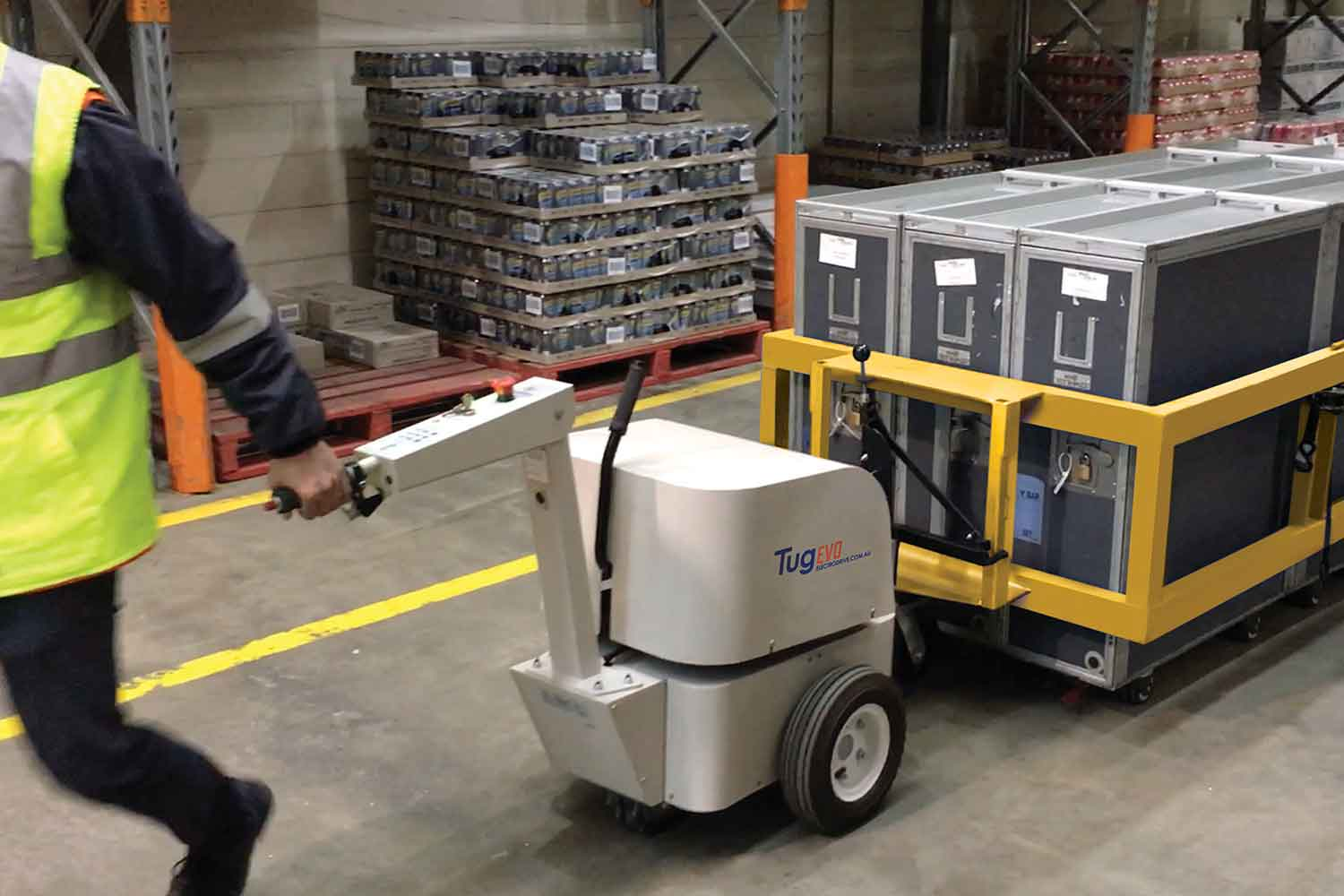 Electrodrive's Tug Evo moving an airline cart