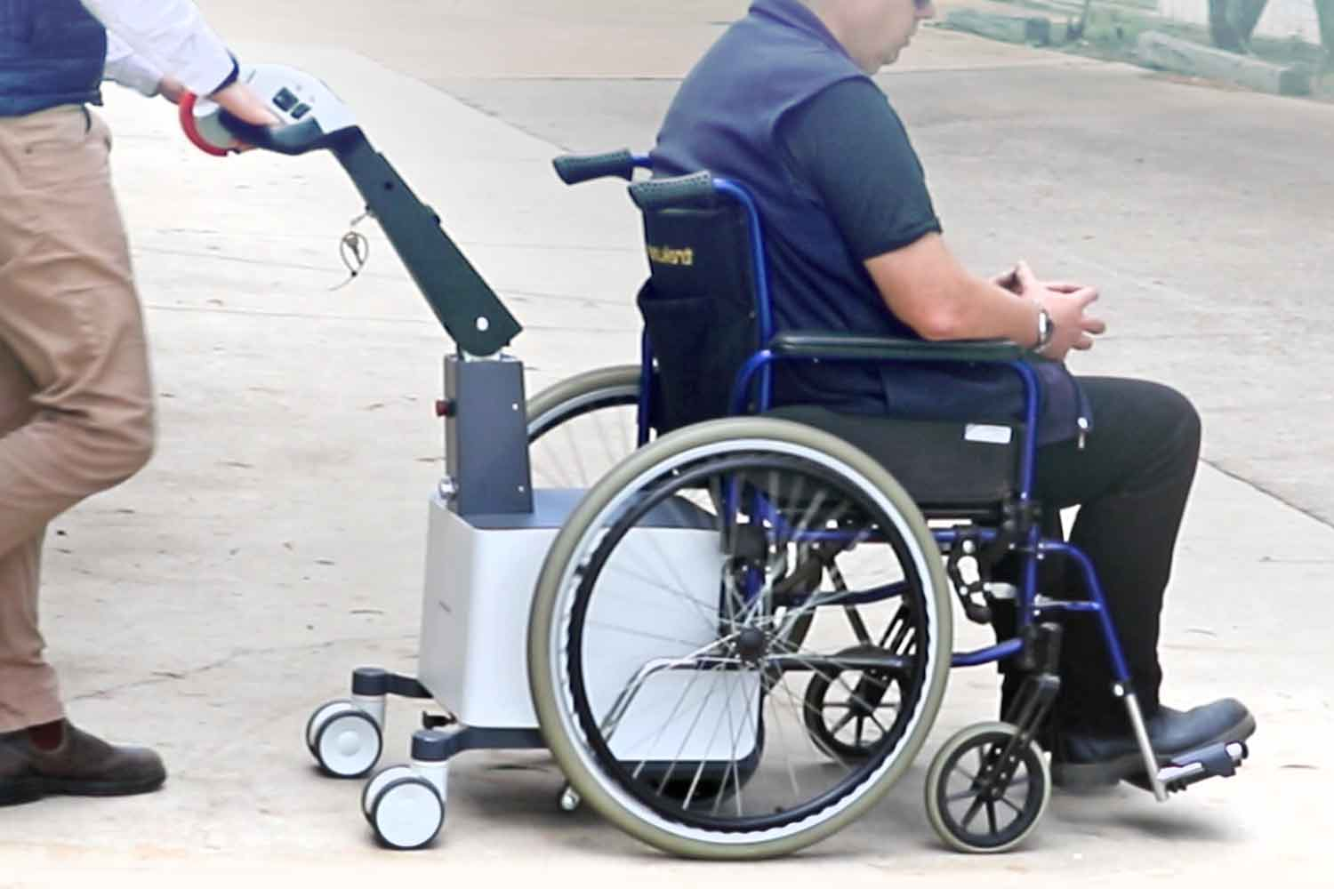 The powered wheelchair mover in action